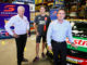Supercars Chief Operating Officer Shane Howard, Chaz Mostert, and Century Yuasa's National Marketing Manager (Automotive) Andrew Bottoms